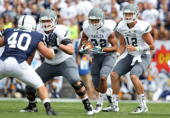 Sep 7, 2013; University Park, PA, USA; Eastern Michigan Eagles running back Javonti Greene (32) runs the ball during the fourth quarter against the Penn State Nittany Lions at Beaver Stadium. Penn State defeated Eastern Michigan 45-7. Mandatory Credit: Matthew O'Haren-USA TODAY Sports