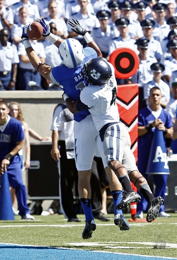 Sep 7, 2013; Colorado Springs, CO, USA; Utah State Aggies corner back Tay Glover-Wright (4) guards Air Force Falcons wide receiver Myles Barnes (11) in the first quarter at Falcon Stadium. Mandatory Credit: Isaiah J. Downing-USA TODAY Sports