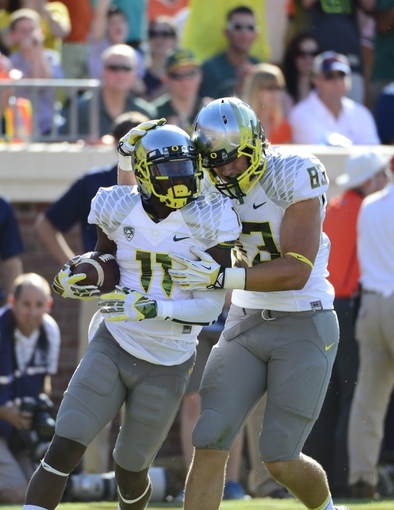 Sep 7, 2013; Charlottesville, VA, USA; Oregon Ducks wide receiver Bralon Addison (11) celebrates with tight end John Mundt (83) after scoring a touch down in the second quarter at Scott Stadium. Mandatory Credit: Bob Donnan-USA TODAY Sports