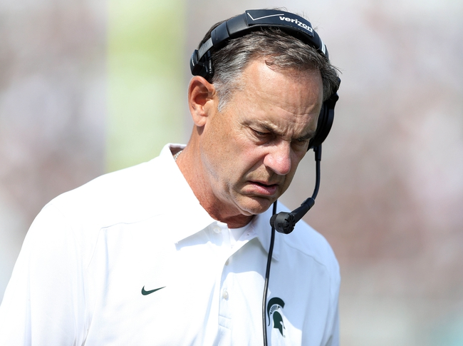 Sep 7, 2013; East Lansing, MI, USA; Michigan State Spartans head coach Mark Dantonio walks the sideline during the 2nd half of a game between the Michigan State Spartans and the South Florida Bulls at Spartan Stadium. MSU won 21-6. Mandatory Credit: Mike Carter-USA TODAY Sports
