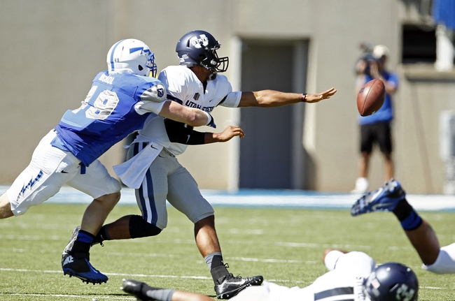 Sep 7, 2013; Colorado Springs, CO, USA; Air Force Falcons linebacker Joey Nichol (49) pressure Utah State Aggies quarterback Chuckie Keeton (16) as he dumps the ball in the first quarter at Falcon Stadium. Mandatory Credit: Isaiah J. Downing-USA TODAY Sports