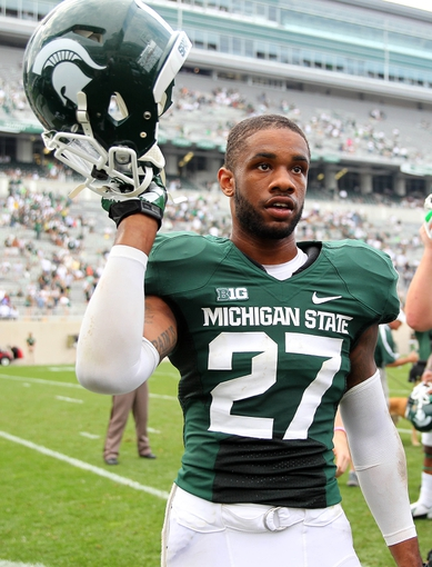 Sep 7, 2013; East Lansing, MI, USA; Michigan State Spartans safety Kurtis Drummond (27) celebrates win after a game between the Michigan State Spartans and the South Florida Bulls at Spartan Stadium. Mandatory Credit: Mike Carter-USA TODAY Sports