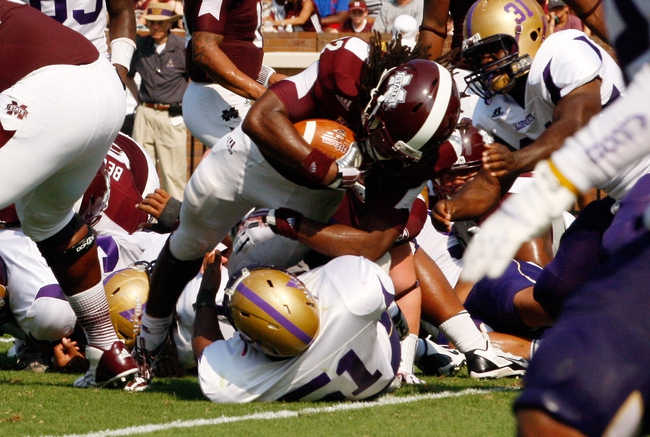Sep 7, 2013; Starkville, MS, USA;  Mississippi State Bulldogs running back Ashton Shumpert (32) scores a touchdown against the Alcorn State Braves at Davis Wade Stadium. Mandatory Credit: Marvin Gentry-USA TODAY Sports