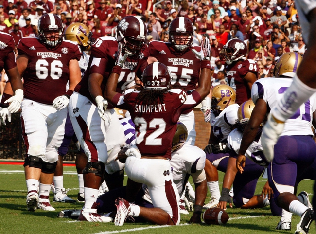 Sep 7, 2013; Starkville, MS, USA;  Mississippi State Bulldogs running back Ashton Shumpert (32) reacts after scoring a touchdown against the Alcorn State Braves at Davis Wade Stadium. Mandatory Credit: Marvin Gentry-USA TODAY Sports
