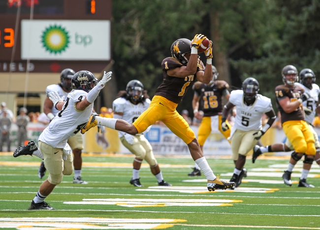 Sep 7, 2013; Laramie, WY, USA; Wyoming Cowboys wide receiver Jalen Claiborne (1) tries to make a catch in front of Idaho Vandals cornerback Jordan Grabski (47) during the first quarter at War Memorial Stadium. Mandatory Credit: Troy Babbitt-USA TODAY Sports
