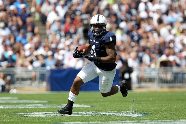Sep 7, 2013; University Park, PA, USA; Penn State Nittany Lions running back Bill Belton (1) runs the ball during the second quarter against the Eastern Michigan Eagles at Beaver Stadium. Penn State defeated Eastern Michigan 45-7. Mandatory Credit: Matthew O'Haren-USA TODAY Sports