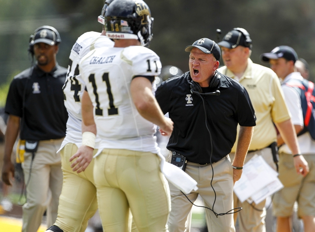 Sep 7, 2013; Laramie, WY, USA; Idaho Vandals head coach Paul Petrino reacts during the first quarter against the Wyoming Cowboys at War Memorial Stadium. Mandatory Credit: Troy Babbitt-USA TODAY Sports