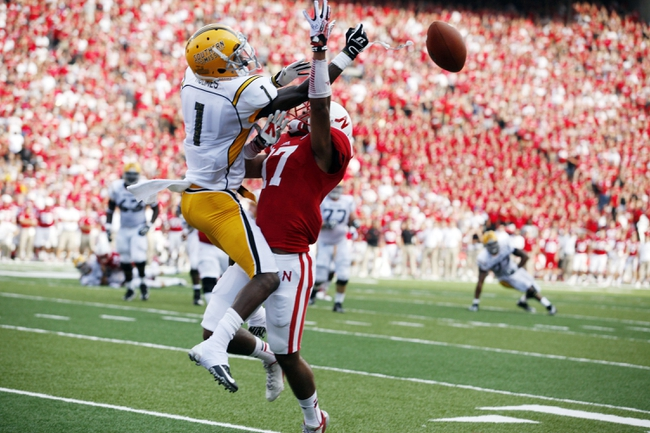 Sep 7, 2013; Lincoln, NE, USA; Nebraska Cornhuskers defender Ciante Evans (17) breaks up a pass intended for Southern Mississippi Golden Eagles receiver Tyre'oune Holmes (1) in the first quarter at Memorial Stadium. Mandatory Credit: Bruce Thorson-USA TODAY Sports