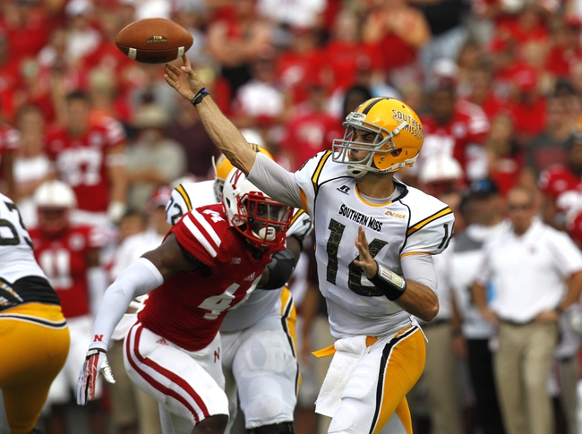 Sep 7, 2013; Lincoln, NE, USA; Southern Mississippi Golden Eagles quarterback Allan Bridgford (16) throws against the Nebraska Cornhuskers in the first quarter at Memorial Stadium. Mandatory Credit: Bruce Thorson-USA TODAY Sports