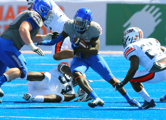 Sep 7, 2013; Boise, ID, USA; Boise State Broncos running back Jay Ajayi (27) breaks through the line for gain during the second half against the Tennessee Martin Skyhawks at Bronco Stadium. Boise State defeated Tennessee Martin 63-14. Mandatory Credit: Brian Losness-USA TODAY Sports