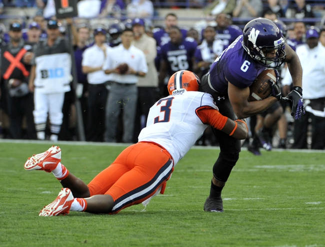 Sep 7, 2013; Evanston, IL, USA;  Northwestern Wildcats wide receiver Tony Jones (6) runs with the ball and is tackled by Syracuse Orange safety Durell Eskridge (3) during the first quarter at Ryan Field. Mandatory Credit: David Banks-USA TODAY Sports