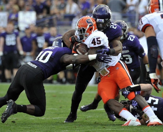 Sep 7, 2013; Evanston, IL, USA;  Syracuse Orange running back Jerome Smith (45) is tackled by Northwestern Wildcats safety Traveon Henry (10) and safety Ibraheim Campbell (24) during the first quarter at Ryan Field. Mandatory Credit: David Banks-USA TODAY Sports