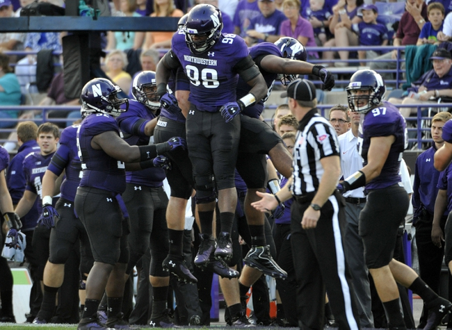 Sep 7, 2013; Evanston, IL, USA;  Northwestern Wildcats defensive lineman Deonte Gibson (98) celebrates a defensive stop against the Syracuse Orange during the first quarter at Ryan Field. Mandatory Credit: David Banks-USA TODAY Sports