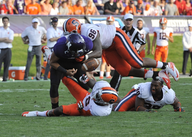 Sep 7, 2013; Evanston, IL, USA;  Syracuse Orange defensive tackle Jay Bromley (96) causes a fumble by Northwestern Wildcats quarterback Kain Colter (2) during the first quarter at Ryan Field. Mandatory Credit: David Banks-USA TODAY Sports