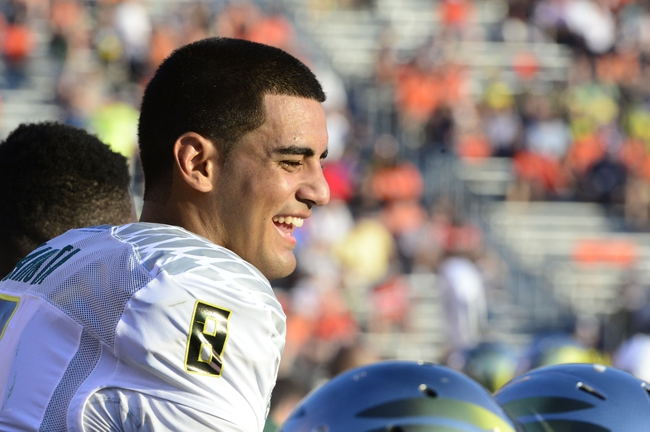 Sep 7, 2013; Charlottesville, VA, USA; Oregon Ducks quarterback Marcus Mariota (8) reacts on the bench late in the fourth quarter. The Ducks defeated the Virginia Cavaliers 59-10 at Scott Stadium. Mandatory Credit: Bob Donnan-USA TODAY Sports