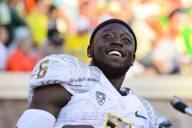 Sep 7, 2013; Charlottesville, VA, USA; Oregon Ducks running back De'Anthony Thomas (6) reacts on the bench late in the fourth quarter. The Ducks defeated the Virginia Cavaliers 59-10 at Scott Stadium. Mandatory Credit: Bob Donnan-USA TODAY Sports
