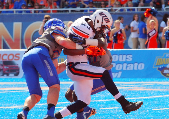 Sep 7, 2013; Boise, ID, USA; Tennessee Martin Skyhawks running back D.J. McNeil (23) scores a touchdown between Boise State Broncos safety Dillon Lukehart (28) and safety Ebo Makinde (37) during the second half at Bronco Stadium.  Boise State defeated Tennessee Martin 63-14.  Mandatory Credit: Brian Losness-USA TODAY Sports