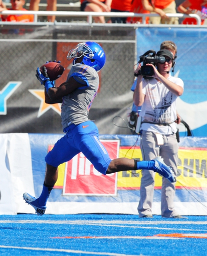Sep 7, 2013; Boise, ID, USA; Boise State Broncos wide receiver Shane Williams-Rhodes (11) catches a pass during the second half against the Tennessee Martin Skyhawks at Bronco Stadium. Boise State defeated Tennessee Martin 63-14. Mandatory Credit: Brian Losness-USA TODAY Sports