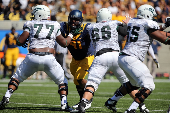 Sep 7, 2013; Berkeley, CA, USA; California Golden Bears defensive lineman Deandre Coleman (91) holds off Portland State Vikings offensive linesman Cornelius Edison (77) and offensive linesman Mitch Gaulke (66) during the first quarter at Memorial Stadium. Mandatory Credit: Kelley L Cox-USA TODAY Sports