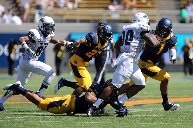 Sep 7, 2013; Berkeley, CA, USA; Portland State Vikings running back DJ Adams (10) carries the ball against the California Golden Bears during the first quarter at Memorial Stadium. Mandatory Credit: Kelley L Cox-USA TODAY Sports
