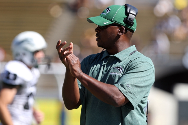 Sep 7, 2013; Berkeley, CA, USA; Portland State Vikings head coach Nigel Burton claps along the sideline against the California Golden Bears during the second quarter at Memorial Stadium. Mandatory Credit: Kelley L Cox-USA TODAY Sports
