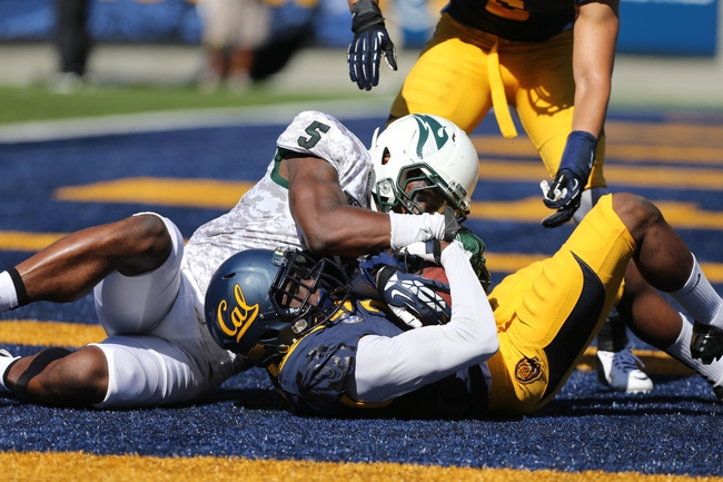 Sep 7, 2013; Berkeley, CA, USA; California Golden Bears defensive back Kameron Jackson (3) intercepts the pass intended for Portland State Vikings wide receiver Roston Tatum (5) during the second quarter at Memorial Stadium. Mandatory Credit: Kelley L Cox-USA TODAY Sports