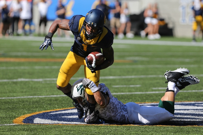 Sep 7, 2013; Berkeley, CA, USA; California Golden Bears wide receiver Bryce Treggs (1) is brought down by Portland State Vikings safety David Edgerson (3) during the second quarter at Memorial Stadium. Mandatory Credit: Kelley L Cox-USA TODAY Sports