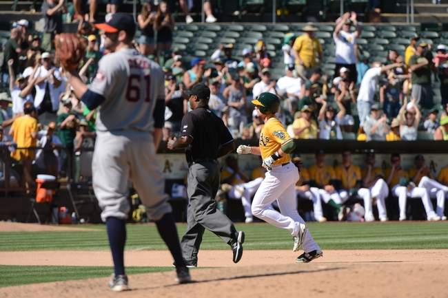 September 7, 2013; Oakland, CA, USA; Oakland Athletics shortstop Jed Lowrie (8, right) rounds the bases after hitting a solo home run off of Houston Astros relief pitcher Joshua Zeid (61) during the seventh inning at O.co Coliseum. The Athletics defeated the Astros 2-1. Mandatory Credit: Kyle Terada-USA TODAY Sports