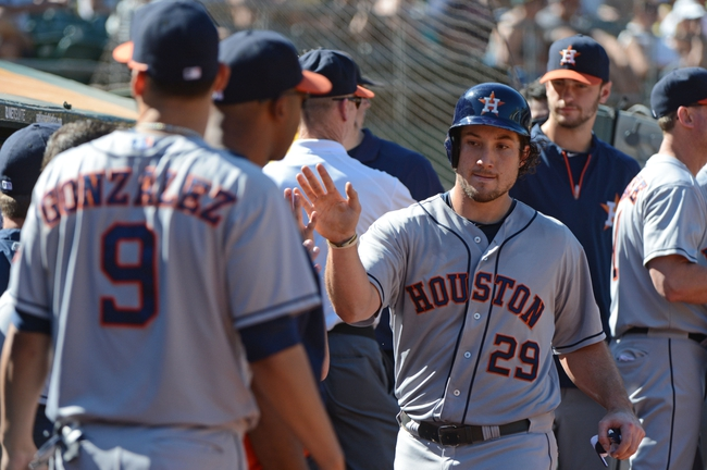 September 7, 2013; Oakland, CA, USA; Houston Astros first baseman Brett Wallace (29) is congratulated by teammates for scoring on a ground ball into a force out by center fielder Brandon Barnes (2, not pictured) against the Oakland Athletics during the eighth inning at O.co Coliseum. The Athletics defeated the Astros 2-1. Mandatory Credit: Kyle Terada-USA TODAY Sports