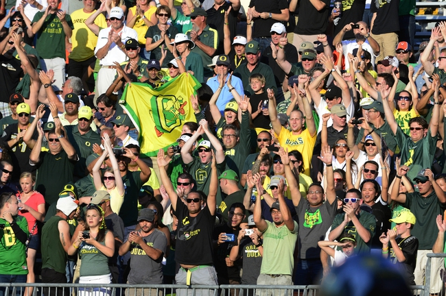 Sep 7, 2013; Charlottesville, VA, USA; Oregon Ducks fans react in the second half. The Ducks defeated the Virginia Cavaliers 59-10 at Scott Stadium. Mandatory Credit: Bob Donnan-USA TODAY Sports
