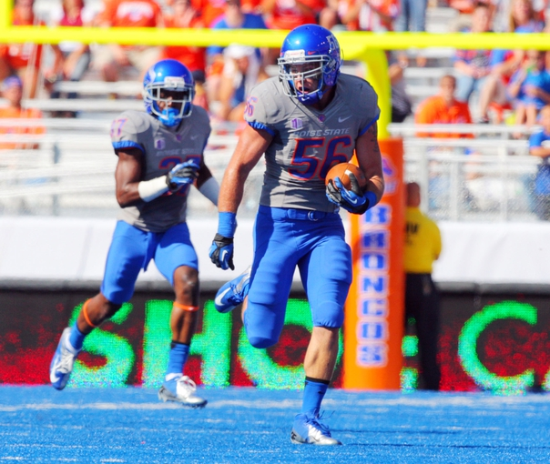Sep 7, 2013; Boise, ID, USA; Boise State Broncos linebacker Dustin Kamper (56) runs back an interception during the second half against the Tennessee Martin Skyhawks at Bronco Stadium. Boise State defeated Tennessee Martin 63-14. Mandatory Credit: Brian Losness-USA TODAY Sports