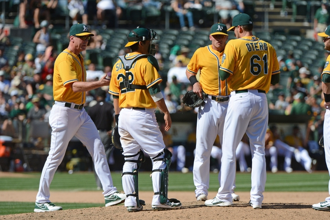September 7, 2013; Oakland, CA, USA; Oakland Athletics manager Bob Melvin (6, far left) removes relief pitcher Dan Otero (61) in a pitching change against the Houston Astros during the eighth inning at O.co Coliseum. The Athletics defeated the Astros 2-1. Mandatory Credit: Kyle Terada-USA TODAY Sports
