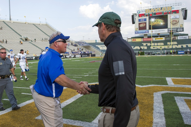Sep 7, 2013; Waco, TX, USA; Buffalo Bulls head coach Jeff Quinn congratulates Baylor Bears head coach Art Briles after the game at Floyd Casey Stadium. The Bears defeated the Bulls 70-13. Mandatory Credit: Jerome Miron-USA TODAY Sports