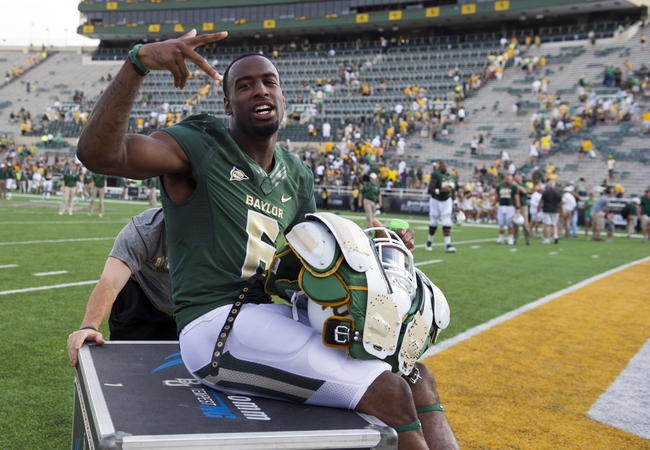 Sep 7, 2013; Waco, TX, USA; Baylor Bears safety Ahmad Dixon (6) celebrates the win over the Buffalo Bulls at Floyd Casey Stadium. The Bears defeated the Bulls 70-13. Mandatory Credit: Jerome Miron-USA TODAY Sports