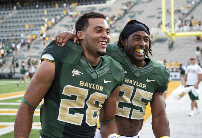 Sep 7, 2013; Waco, TX, USA; Baylor Bears running back Lache Seastrunk (25) and running back Devin Chafin (28) celebrate the win over the Buffalo Bulls. The Bears defeated the Bulls 70-13. Mandatory Credit: Jerome Miron-USA TODAY Sports