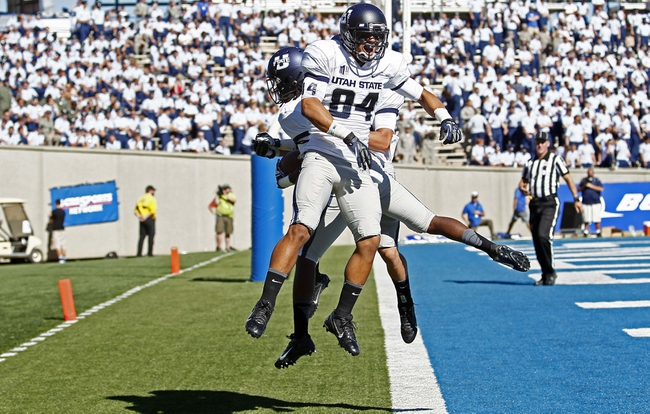 Sep 7, 2013; Colorado Springs, CO, USA; Utah State Aggies wide receiver Shaan Johnson (84) celebrates with wide receiver Ronald Butler (18) after his touchdown in the third quarter against the Air Force Falcons at Falcon Stadium. The Aggies won 52-20. Mandatory Credit: Isaiah J. Downing-USA TODAY Sports