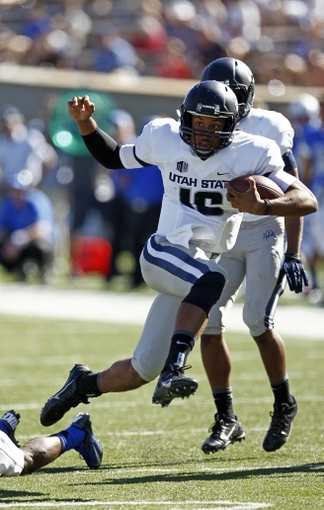 Sep 7, 2013; Colorado Springs, CO, USA; Utah State Aggies quarterback Chuckie Keeton (16) runs the ball in the third quarter against the Air Force Falcons at Falcon Stadium. The Aggies won 52-20. Mandatory Credit: Isaiah J. Downing-USA TODAY Sports