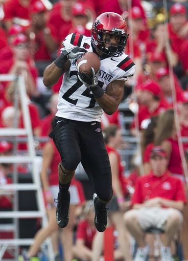 Sep 7, 2013; Columbus, OH, USA; San Diego State Aztecs wide receiver Colin Lockett (24) makes a catch in the air against the Ohio State Buckeyes at Ohio Stadium. Ohio State won the game 42-7. Mandatory Credit: Greg Bartram-USA TODAY Sports