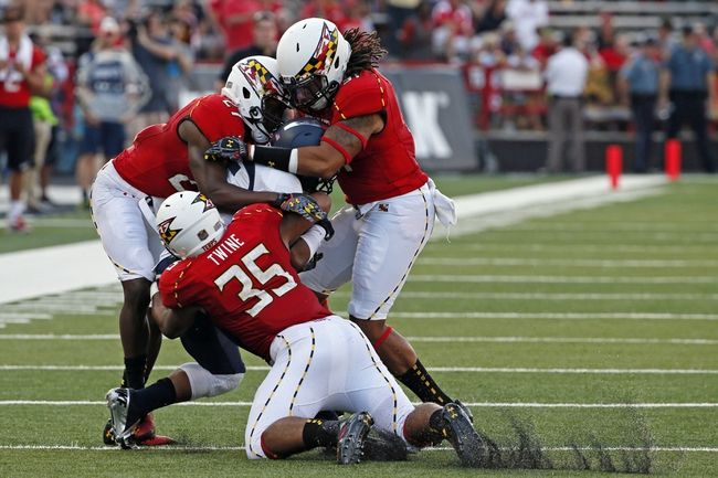 Sep 7, 2013; College Park, MD, USA; Maryland Terrapins special team player Alex Twine (35) leads the tackle of Old Dominion Monarchs kick returner Aaron Evans (15) at Byrd Stadium. Mandatory Credit: Mitch Stringer-USA TODAY Sports
