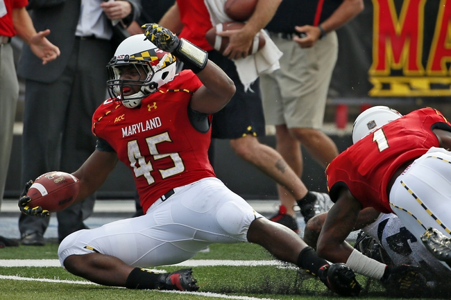 Sep 7, 2013; College Park, MD, USA; Maryland Terrapins running back Brandon Ross (45) gains yardage against the Old Dominion Monarchs at Byrd Stadium. Mandatory Credit: Mitch Stringer-USA TODAY Sports