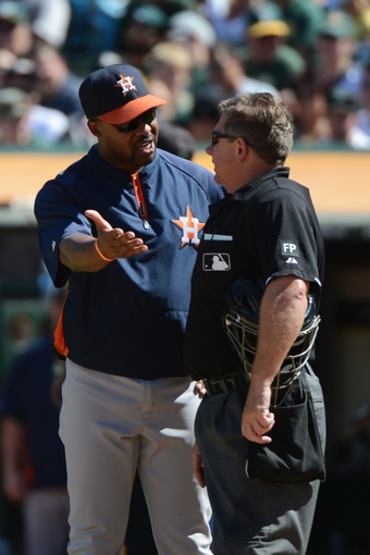 September 7, 2013; Oakland, CA, USA; Houston Astros manager Bo Porter (16, left) argues with MLB umpire Greg Gibson (53, right) against the Oakland Athletics during the sixth inning at O.co Coliseum. The Athletics defeated the Astros 2-1. Mandatory Credit: Kyle Terada-USA TODAY Sports