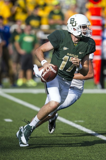 Sep 7, 2013; Waco, TX, USA; Baylor Bears quarterback Seth Russell (17) rolls out with the ball during the second half against the Buffalo Bulls at Floyd Casey Stadium. The Bears defeated the Bulls 70-13. Mandatory Credit: Jerome Miron-USA TODAY Sports