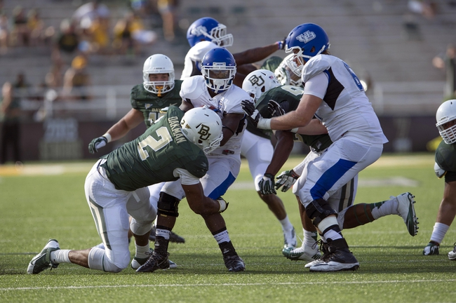 Sep 7, 2013; Waco, TX, USA; Buffalo Bulls running back James Potts (1) is tackled by Baylor Bears defensive end Shawn Oakman (2) during the second half at Floyd Casey Stadium. The Bears defeated the Bulls 70-13. Mandatory Credit: Jerome Miron-USA TODAY Sports