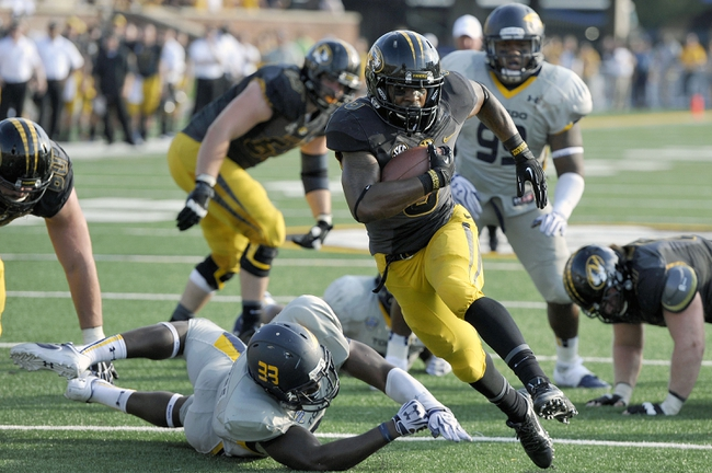 Sep 7, 2013; Columbia, MO, USA;  Missouri Tigers running back Marcus Murphy (6) scores a touchdown against the Toledo Rockets during the second half. Missouri defeats Toledo 38-23 at Faurot Field . Mandatory Credit: Jasen Vinlove-USA TODAY Sports