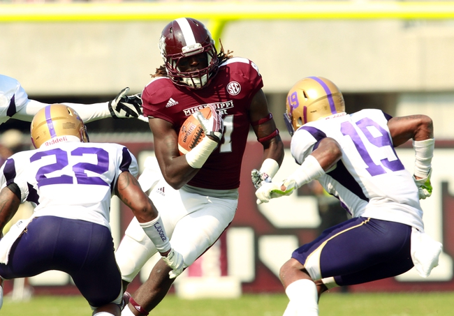 Sep 7, 2013; Starkville, MS, USA;  Mississippi State Bulldogs wide  receiver De'Runnya Wilson (81) carries the ball against the Alcorn State Braves at Davis Wade Stadium.  The Bulldogs defeated the Braves 51-7. Mandatory Credit: Marvin Gentry-USA TODAY Sports