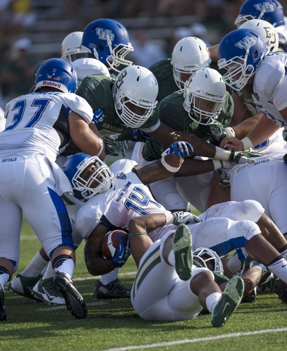Sep 7, 2013; Waco, TX, USA; Buffalo Bulls running back Anthone Taylor (14) is brought down by the Baylor Bears defense during the second half at Floyd Casey Stadium. The Bears defeated the Bulls 70-13. Mandatory Credit: Jerome Miron-USA TODAY Sports