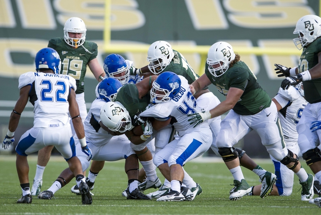 Sep 7, 2013; Waco, TX, USA; Baylor Bears running back Devin Chafin (28) is tackled by Buffalo Bulls linebacker Nick Gilbo (43) during the second half at Floyd Casey Stadium. The Bears defeated the Bulls 70-13. Mandatory Credit: Jerome Miron-USA TODAY Sports