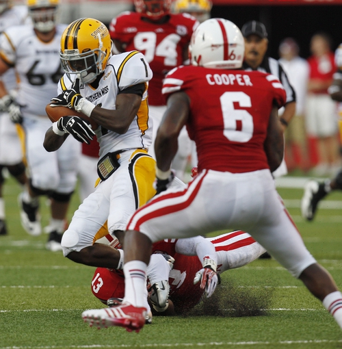 Sep 7, 2013; Lincoln, NE, USA; Southern Mississippi Golden Eagles receiver Tyre'oune Holmes (1) catches a pass in front of Nebraska Cornhuskers defender Corey Cooper (6) in the second quarter at Memorial Stadium. Mandatory Credit: Bruce Thorson-USA TODAY Sports