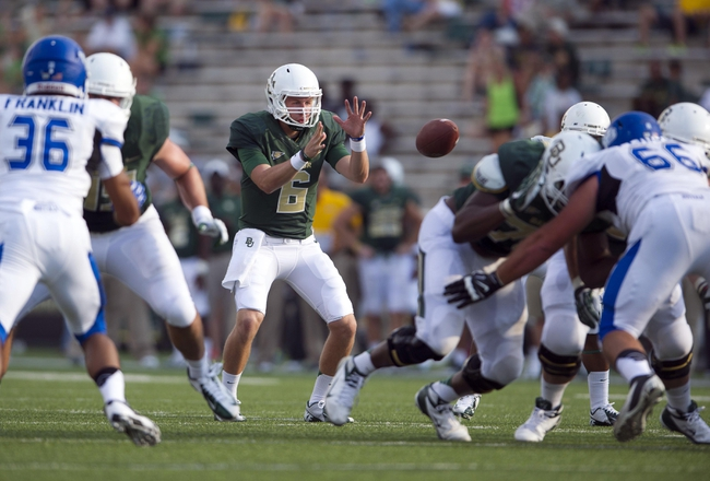 Sep 7, 2013; Waco, TX, USA; Baylor Bears quarterback Andrew Frerking (6) takes a snap against the Buffalo Bulls defense during the second half at Floyd Casey Stadium. The Bears defeated the Bulls 70-13. Mandatory Credit: Jerome Miron-USA TODAY Sports