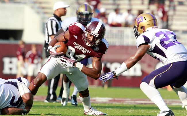 Sep 7, 2013; Starkville, MS, USA;  Mississippi State Bulldogs wide receiver Jeremey Chappelle (84) is grabbed by Alcorn State linebacker William Thomas (51) at Davis Wade Stadium.  The Bulldogs defeated the Braves 51-7. Mandatory Credit: Marvin Gentry-USA TODAY Sports